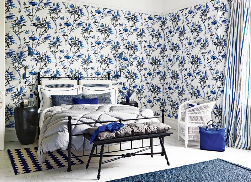 Blue Modern Bedroom With Patterned Wallpaper And Metal Bedstead
