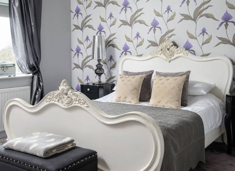 Glamorous Modern Bedroom With Floral Wallpaper And Centrepiece Bed