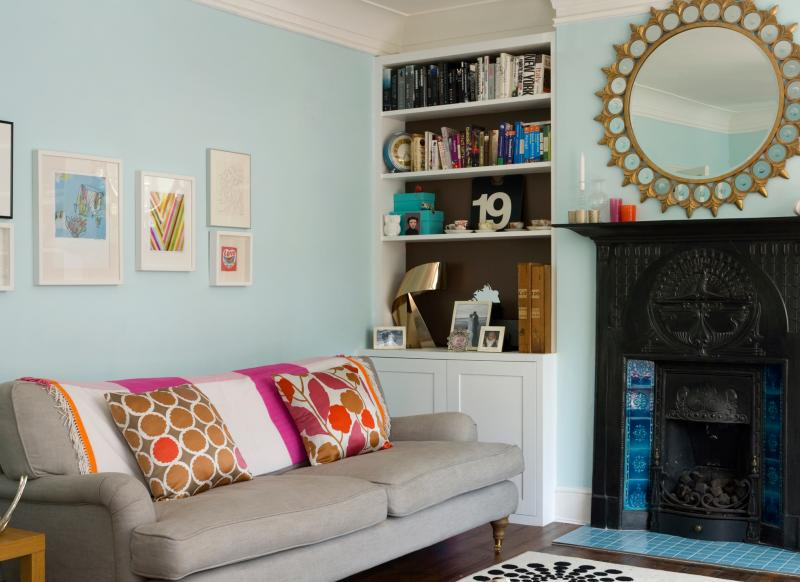 Pale Blue Living Room With Gold Mirror