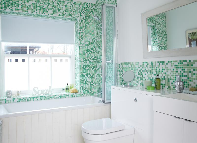 Modern Green and White Tiled Bathroom