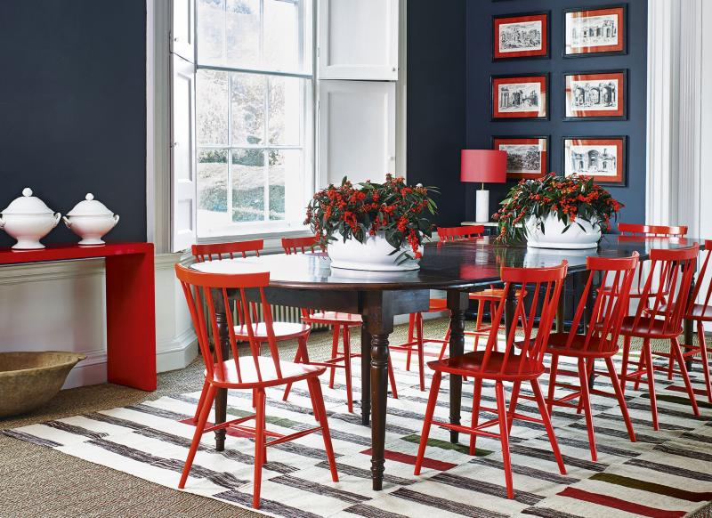 Monochrome Dining Room With Bright Red Chairs