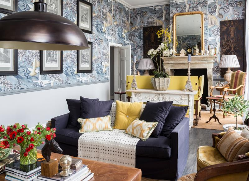 Traditional living room with large scale blue wallpaper