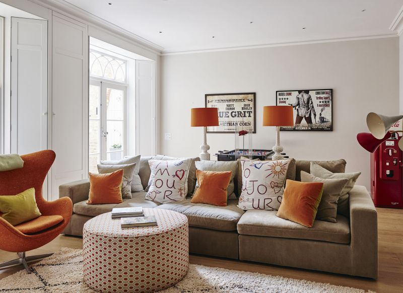 Informal Living Room With Orange Accents And White Walls Part 44