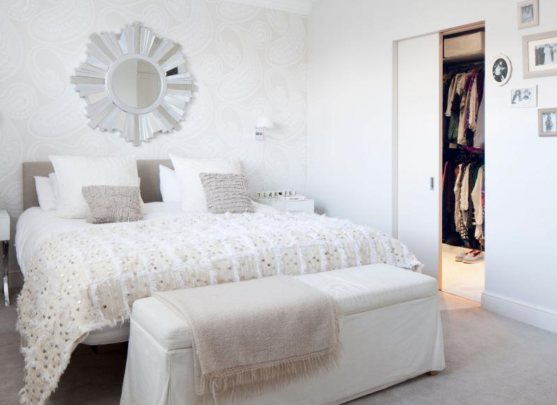 Sparkling Bedroom with Textured Fabrics and Statement Mirror