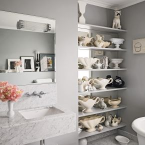 Grey and marble bathroom with eclectic display shelves