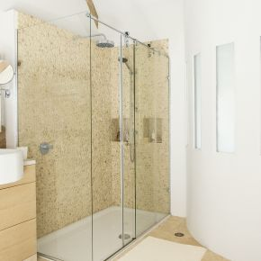Neutral Shower Room With Curved Feature Wall