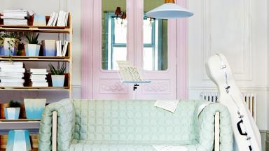 Pastel Living Room with Mint Green Sofa and Cello Case