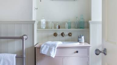 Neutral Bathroom with Pastel Vanity Unit and Vintage Mirror
