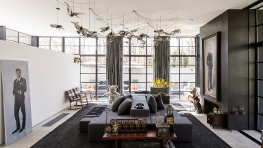 Contemporary black living room with floor to ceiling windows