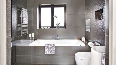 Glamorous Grey Bathroom with Shimmering Metallic Tiles