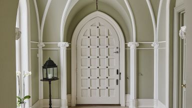 Gothic Hallway with Large White Door and Lantern