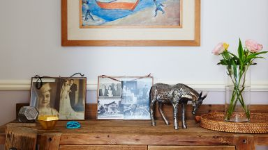 Neutral Country Hallway with Wooden Console Table and Artwork