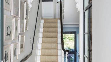 White Modern Hallway with Large Pendant and Stair Runner
