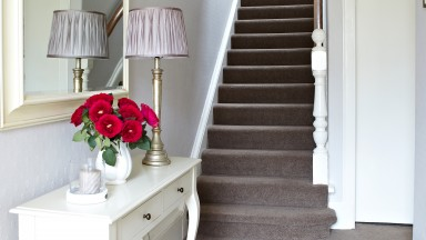 White Traditional Hallway with Taupe Carpet and French-style Console Table