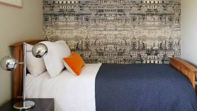 Traditional Guest Bedroom with Cityscape Wallpaper