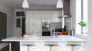 Modern White Kitchen with Hi-gloss Units and Breakfast Bar
