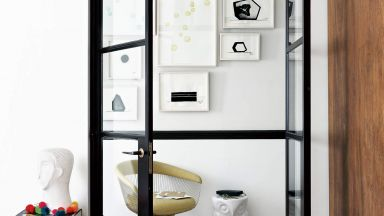 Monochrome Hallway with Double Doors and Artwork