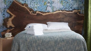 Contemporary Bedroom with Bark-inspired Wallpaper and Oak Headboard