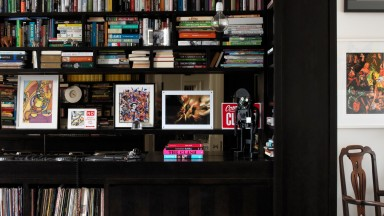 Mezzanine library with black built-in shelving