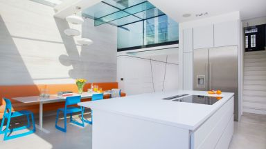 Modern White Kitchen with Bright Orange Banquette