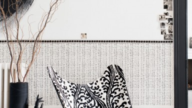 Monochrome Hallway with Printed Wallpaper and Graphic-print Chair