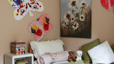 Child's neutral bedroom with paintings