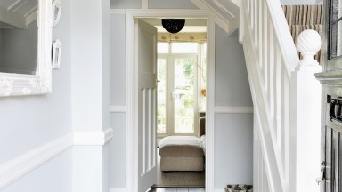 Pale blue and white traditional hallway