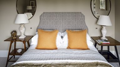 Neutral Traditional Bedroom With Orange Cushions