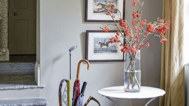 Grey Country Hallway with Side Table and Trio of Framed Prints