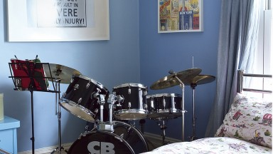 Blue teenager's bedroom with drum kit