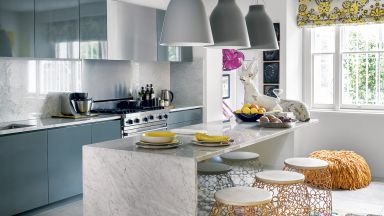 Sleek marble kitchen with Bohemian living area