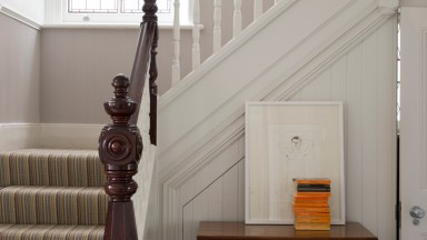 Traditional hallway with white banister