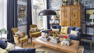 Bold blue living room with feature wallpaper and yellow accents