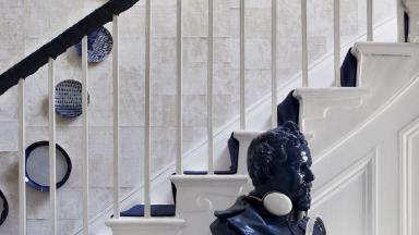 Modern White Hallway with Blue Bust