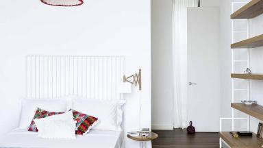 Teenager's Modern White Bedroom with Red Pendant Light