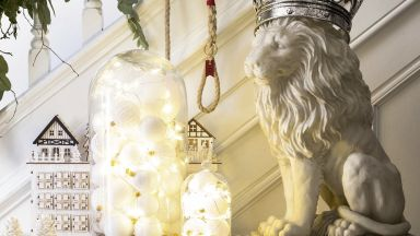 Traditional White Christmas Hallway with Fresh Foliage and Bell Jar Lights