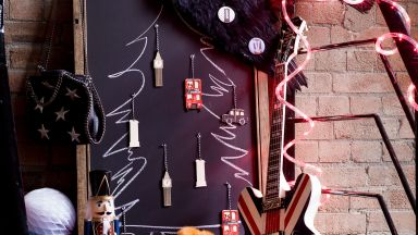 Punk-themed Christmas hallway with Union Jack guitar