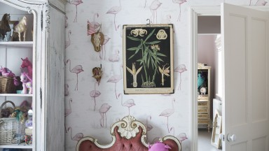 Children's Room with Flamingo Wallpaper and Ornate Chair