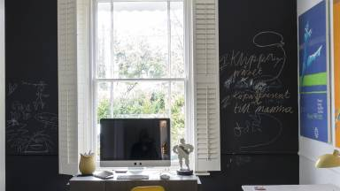 Modern Family Home Office with Chalkboard Wall and Shutters