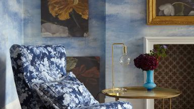 Living Room with Painterly Wallpaper and Floral Upholstered Chair