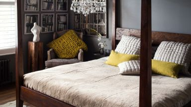 Dark Atmospheric Bedroom With Four-poster Bed and Low Chandelier