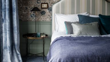 Traditional Bedroom with Botanical Printed Wallpaper and Oversized Headboard