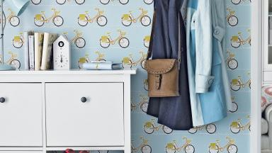 Modern Hallway with Bicycle-print Wallpaper and White Storage Cabinet
