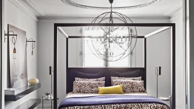 Master Bedroom With Black Four-poster Bed and Signature Lighting