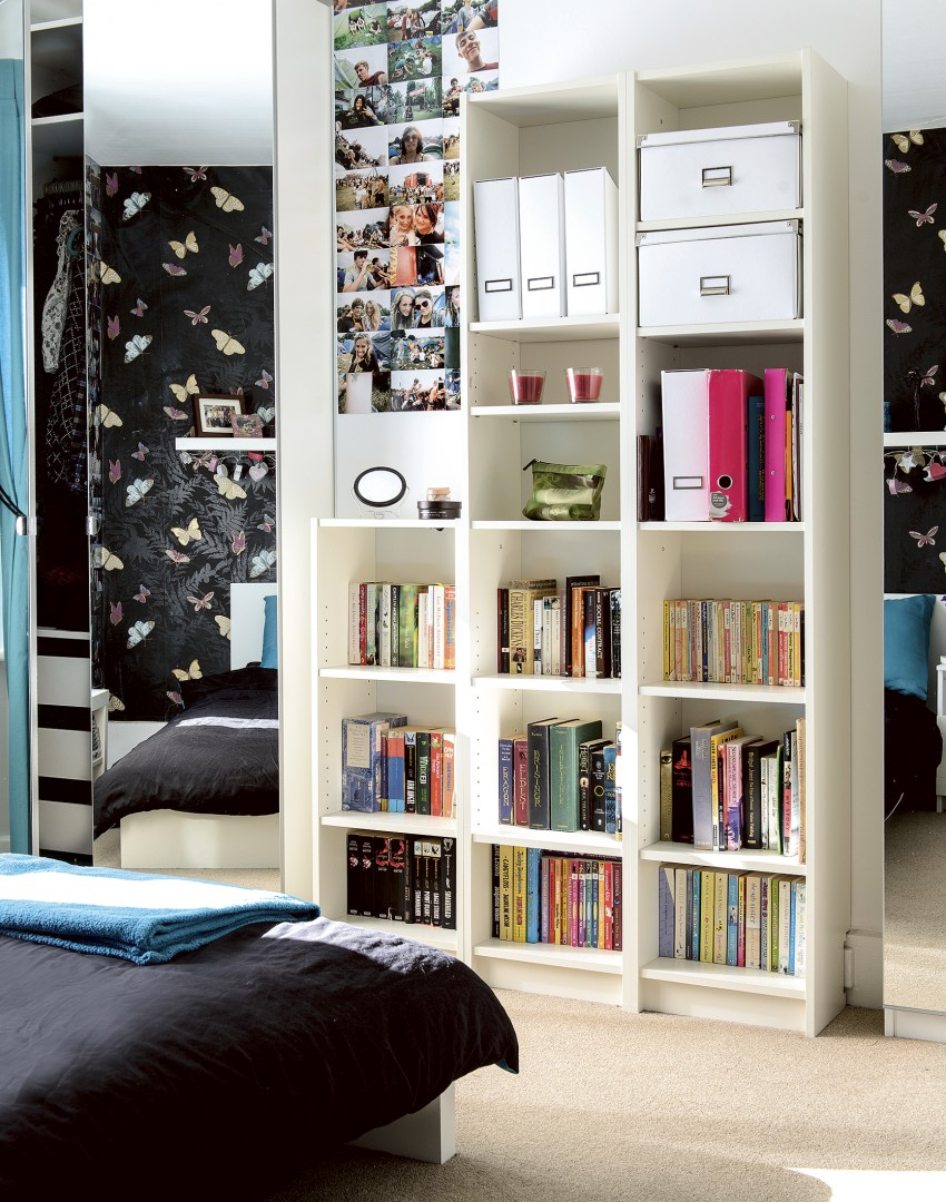 Teenager's bedroom with large bookcase