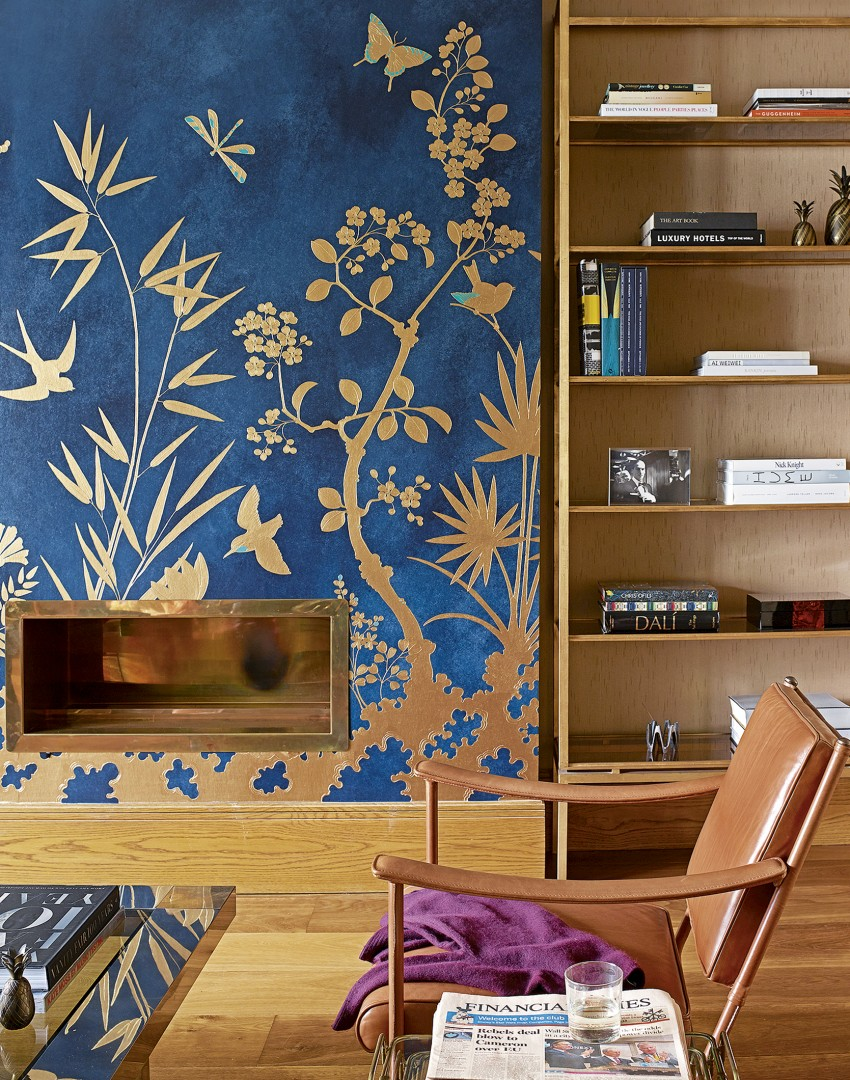 Blue living room with gold wall detail