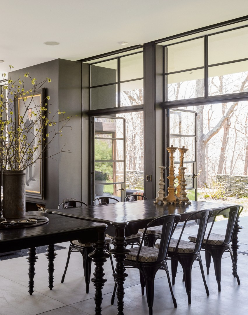 Contemporary Black Dining Room With Concrete Floor