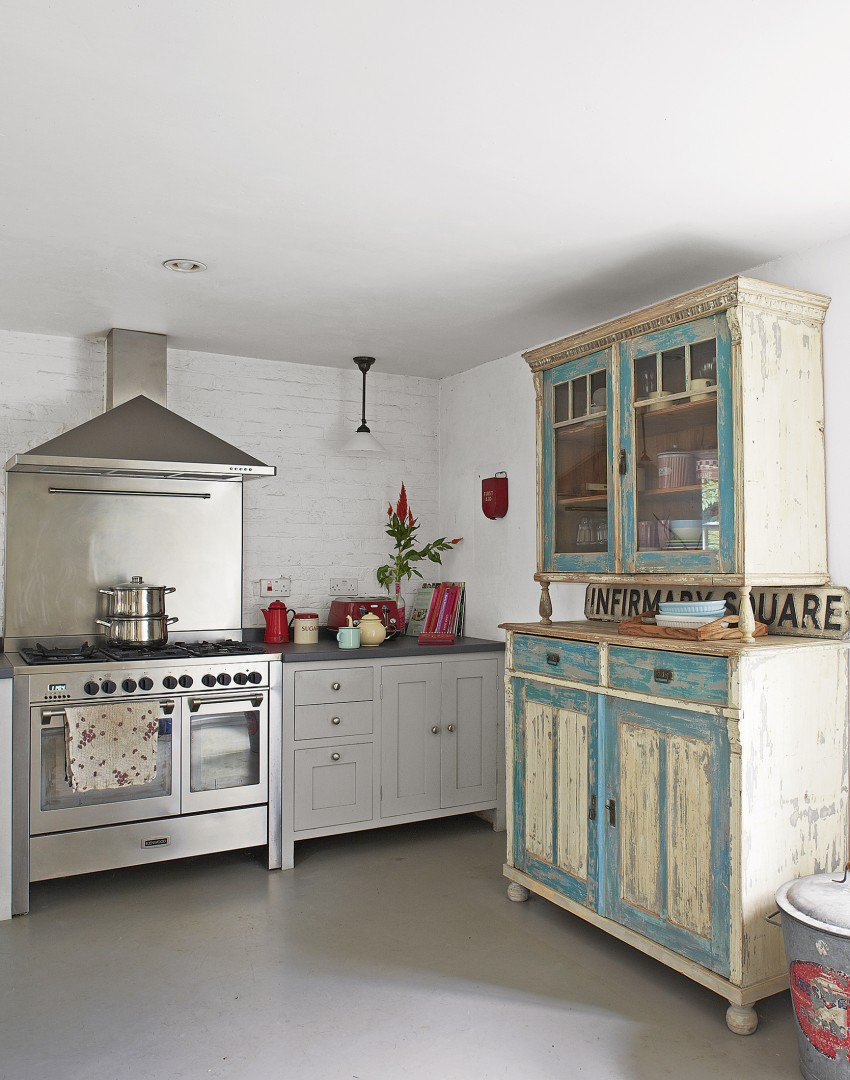 Country kitchen with distressed vintage dresser