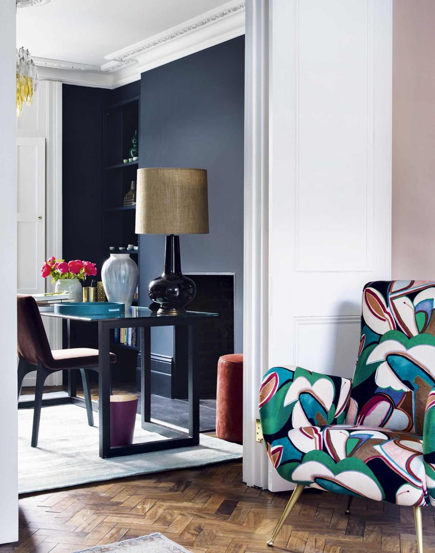 Charcoal grey home office with abstract patterned armchair