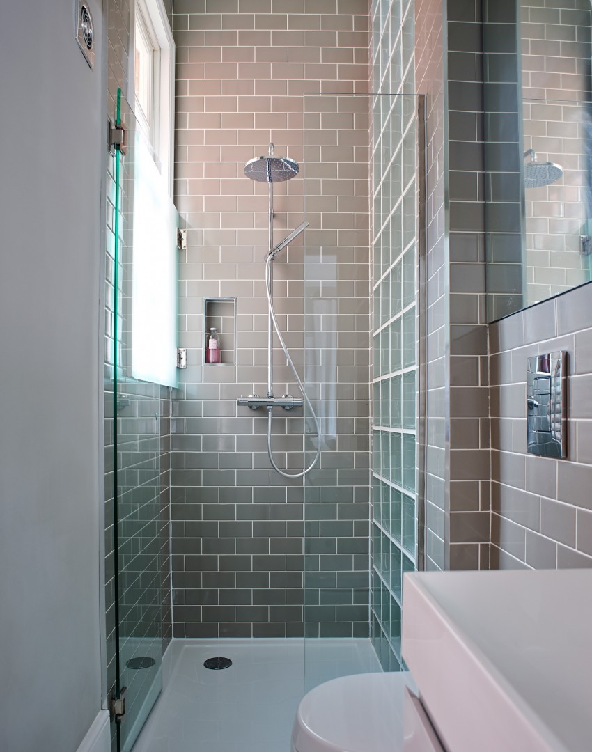 Modern grey tiled shower cubicle